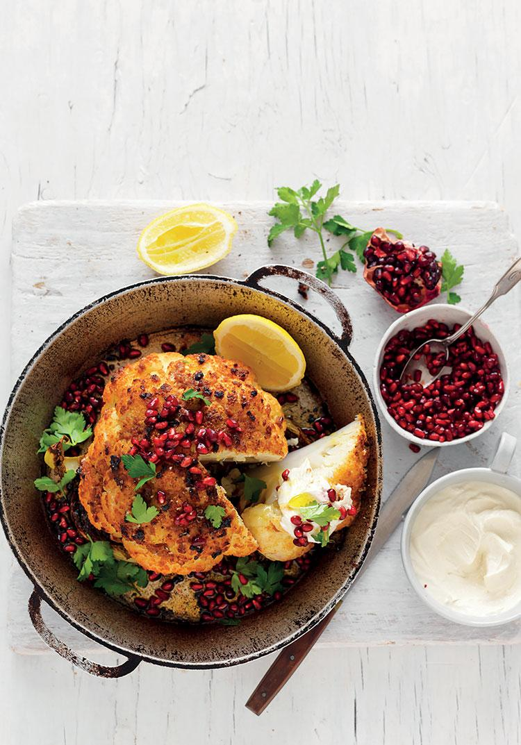 Whole roasted spiced cauliflower with tahini yoghurt & pomegranate
