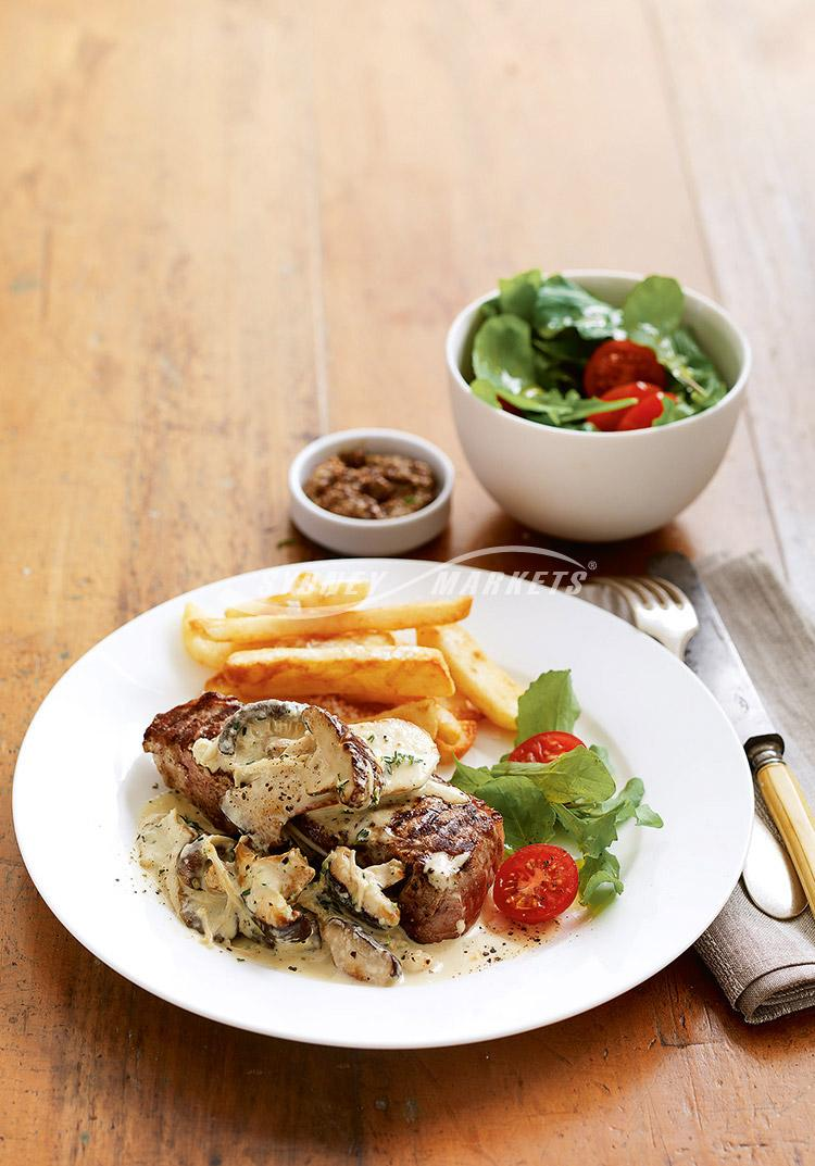 Creamy mushroom sauce with barbecue steaks