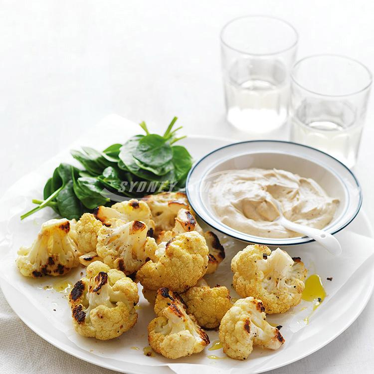Roasted spiced cauliflower with tahini yoghurt dressing