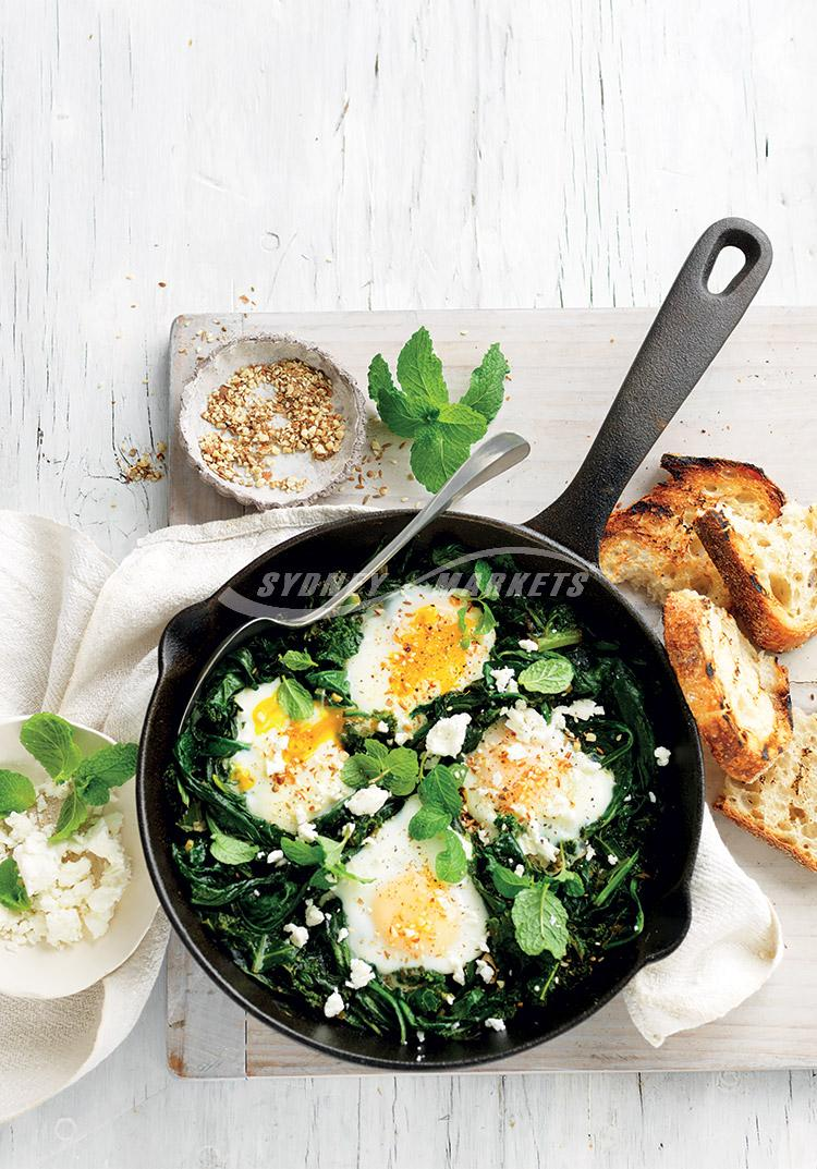 Sauteed greens with eggs, mint & feta